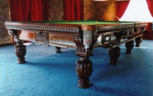 Decoratively carved antique snooker table