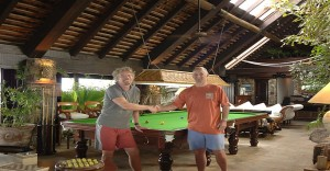 Sir Richard Branson and Mr Peter Ludgate of Hubble Sports with the original Snooker Table at Necker Island before the great fire in 2011